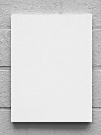 blank canvas: Painter canvas on wall black and white background Stock Photo