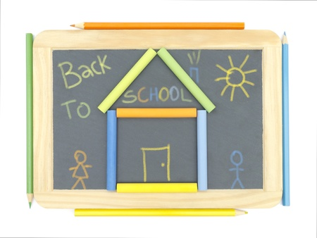 kiddie: Chalkboard with drawing chalks and pencils Stock Photo
