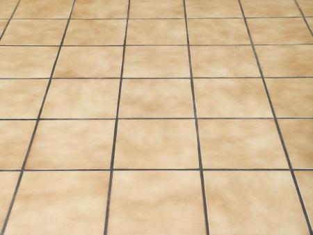 Brown ceramic floor tiles closeup texture photo