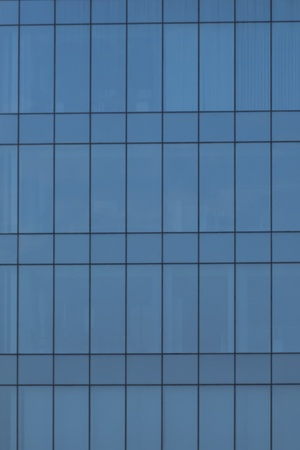 Blue glass windows texture from office building exterior Stock Photo
