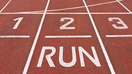 Running track starting position with run written on it photo