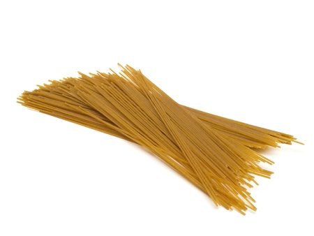 wholemeal: Spaghetti from wholemeal durum wheat on white background Stock Photo