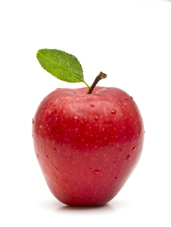 apple: Beautiful red apple with green leaf on white background Stock Photo