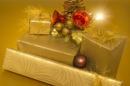 Christmas gifts on golden background photo