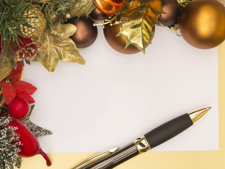 space to write: Christmas card with decoration and pen Stock Photo