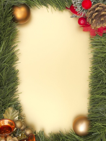 Christmas decorated frame on yellow background photo