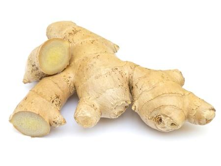 Fresh ginger on white background photo