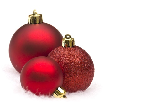 baubles christmas balls: Red christmas balls on white background Stock Photo