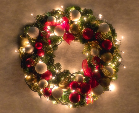 balls decorated: Christmas wreath lit on snowy background