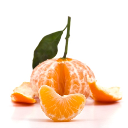 sectioned: Clementine peeled on white background Stock Photo