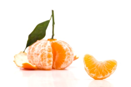 sectioned: Fresh clementine peeled on white background