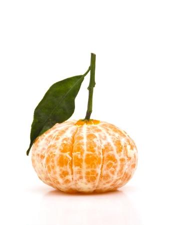 Peeled clementine on white background photo