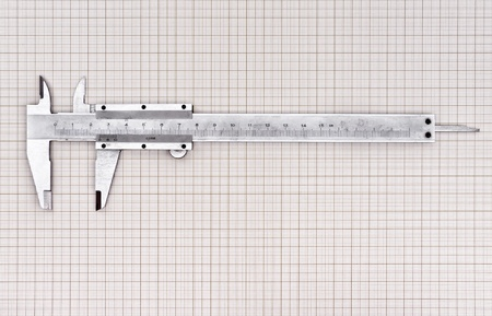 Caliper measuring one inch in centimeter on graph paper Stock Photo - 11855286