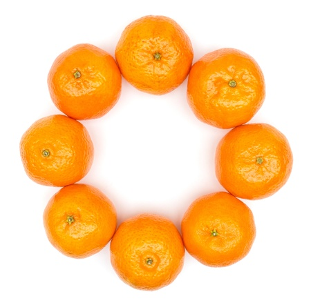 clementine: Circle of oranges on white background