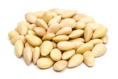 Peeled almonds pile on white background