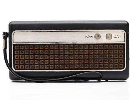 Old portable radio on white background photo