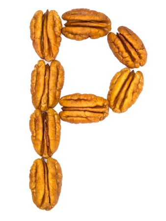 Pecan nuts letter on white background photo