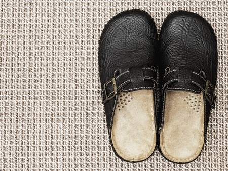 Leather slippers on carpet with copy space photo