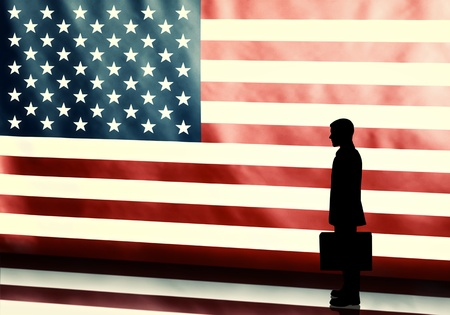 Silhouette of a politician with briefcase on american flag background with vintage look photo