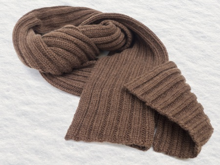 Brown winter scarf in snow  Stock Photo - 12870262