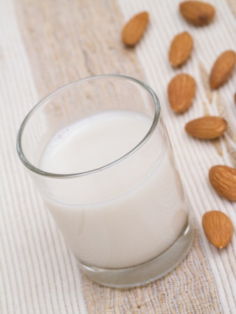 Almond milk glass with nuts photo