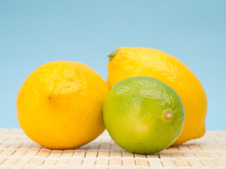 Citrus fruit on mat against blue background photo