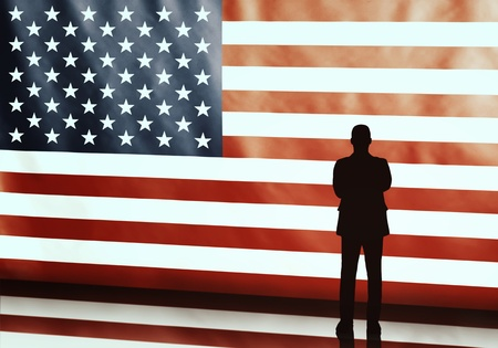 politician: Silhouette of an american politician with arms crosses on flag background Stock Photo