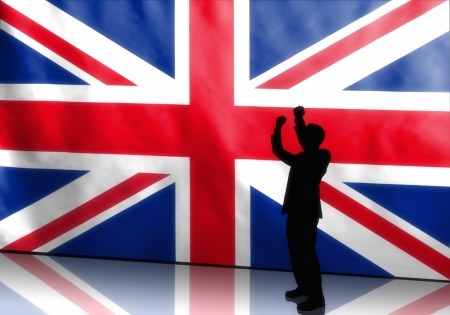 Silhouette of a cheering british politician on flag background photo