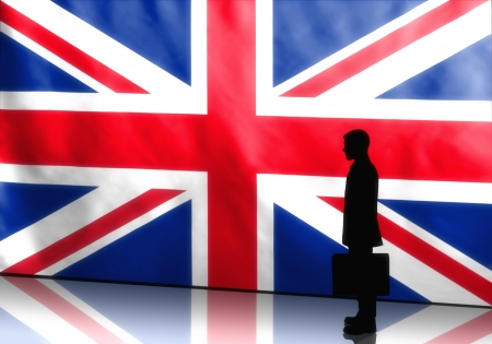 Silhouette of a british politician with briefcase on flag background photo