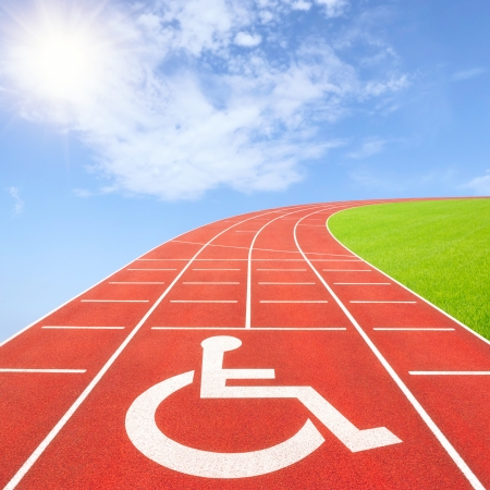 disabled sports: Summer competition for athletes with disabilitiess concept with disability symbol on running track