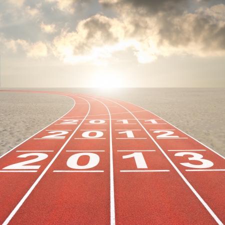 Fresh start 2013 concept with running track in desert photo