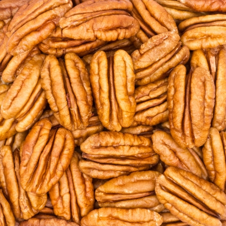 Closeup of pecan nuts for background  Stock Photo