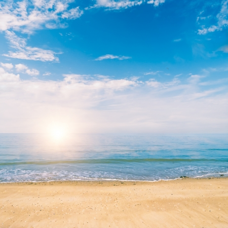 Beautiful view of ocean and beach on sunny day photo