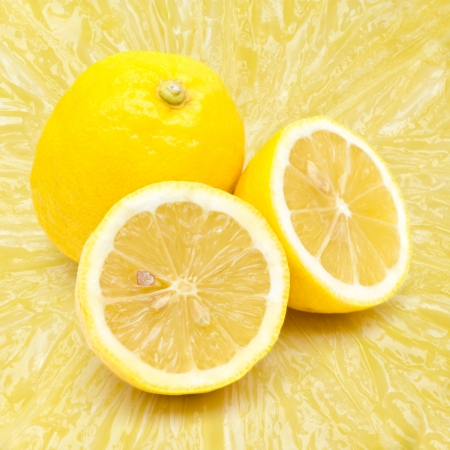 Lemon fruit on flesh background photo