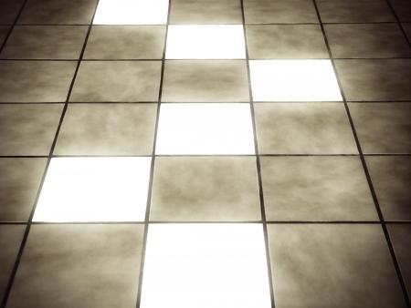 Illuminated tiles on ceramic floor Stock Photo - 14327974