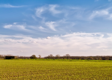 painterly: Farmland with bunker and painterly sky Stock Photo