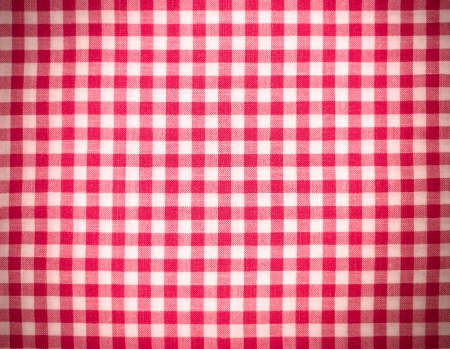 checker: Red tablecloth background with vignette Stock Photo