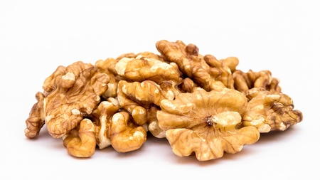 Walnuts pile on white background photo