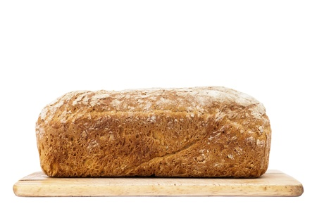 Loaf of bread on cutting board isolated on white photo