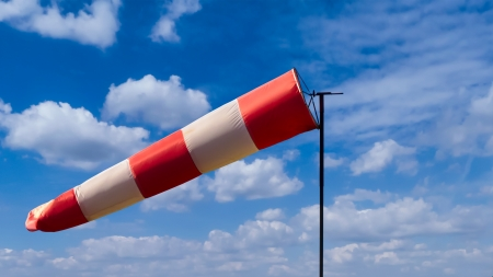 Windsock on cloudy blue sky photo