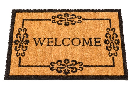 doorstep: New welcome mat isolated on white background