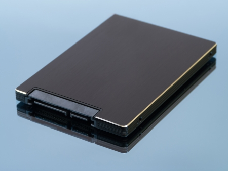 solid state drive: Solid state drive on blue background with reflection