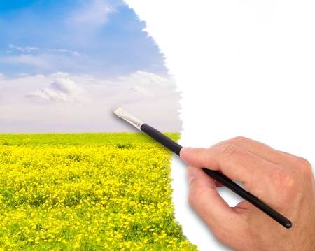 buttercup flower: Hand holding paintbrush painting buttercup flower field with copy space