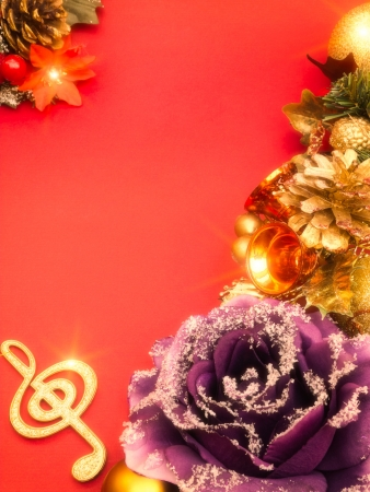 Musical christmas decoration on red background photo