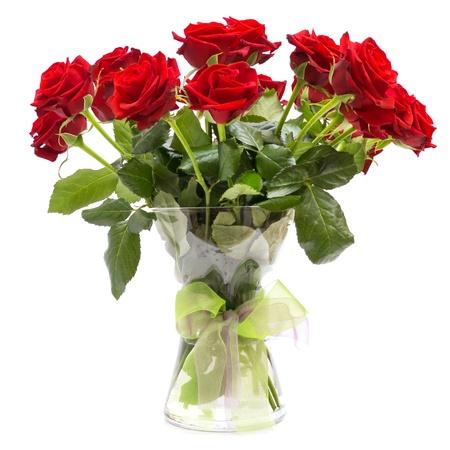 白い背景で隔離のリボンでガラスの花瓶にバラのブーケ 写真素材