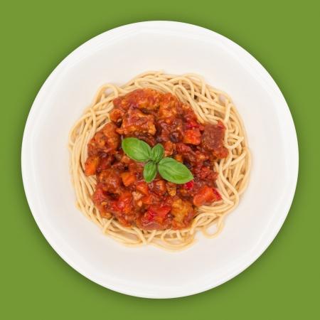 salsa de tomate: Spaghetti vista sobre la placa superior sobre fondo verde Foto de archivo