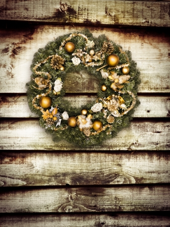 Christmas wreath hanging on wooden wall photo