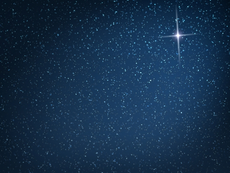 christmas religious: Christmas star on evening snowfall Stock Photo