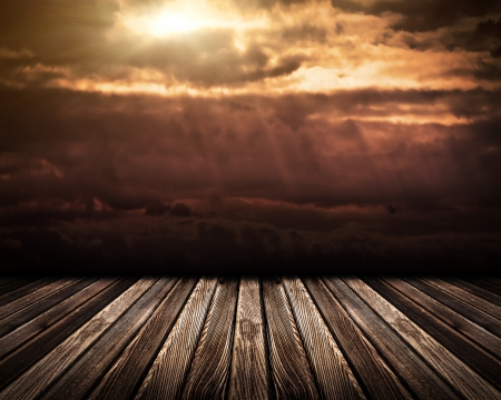 Wooden floor on dramatic sky photo