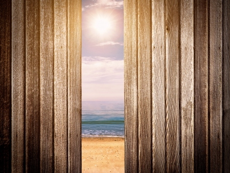 trough: Looking through wooden fence at beach